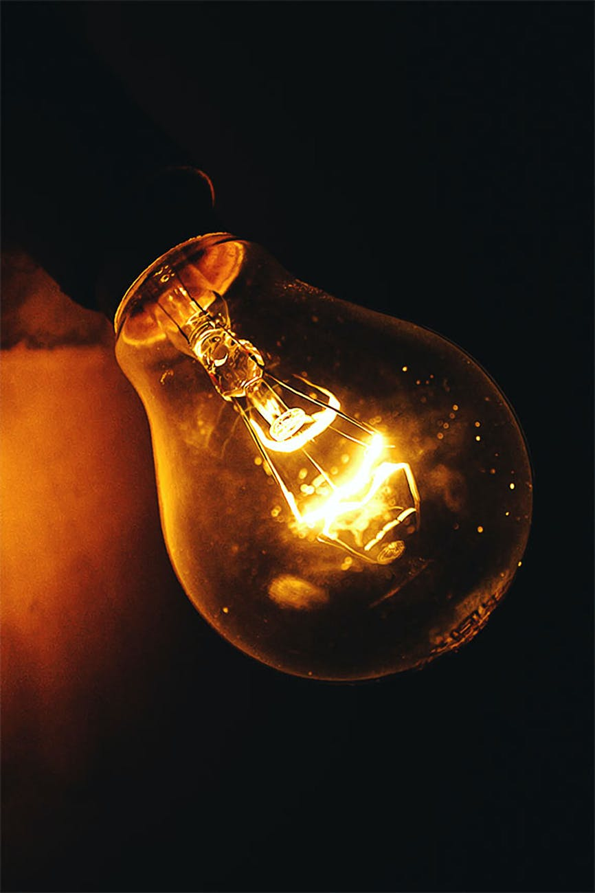 close up photography of lighted light bulb